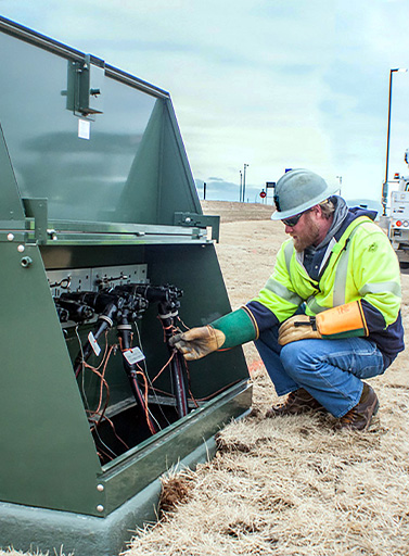 Utility Worker working on equipment